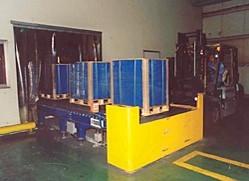 Impianto trasporto e wrappatura pallet